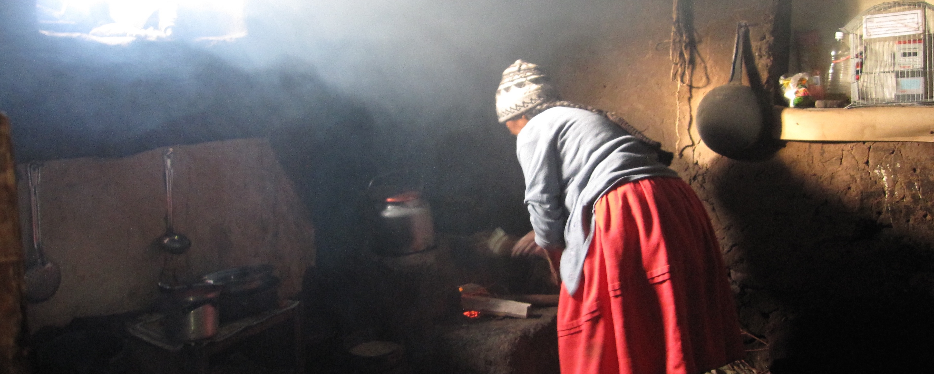 Woman cooking on traditional indoor stove